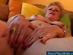 Sexy granny showing her shaven pussy