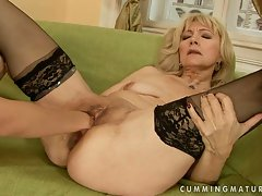 This nympho cougar gets her hairy pussy pummeled with a big fist