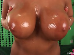 Sizzling Lucy Love oils up her massive knockers for you