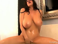 Luscious Kelly Madison loves teasing her moist clit
