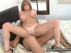 Horny cougar Darla Crane likes getting stuck by a big, fat dick