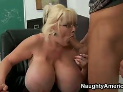 Kayla Kleevage enjoys giving a young guy a lusty blowjob one night