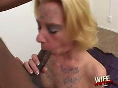 Whore Miss Dee eating a long black flesh tube
