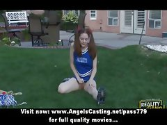 Amateur amazing redhead cheerleader teen training outside