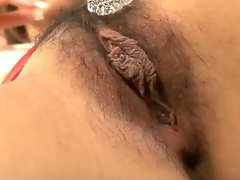 Horny Arisa oils up her furry pussy and fingers her twat like mad