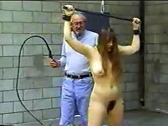 Old man whips a girl in bondage