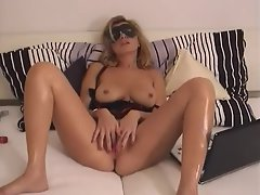 A hot masked milf masturbates her sexy pussy