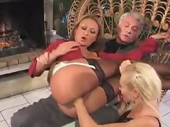 Girl in his lap gets fisted by a lesbian