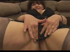 Teasing mature in stockings showing her hairy pussy