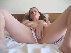 Adorable chick masturbating her pussy