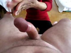 Asian girl gives his big cock a handy