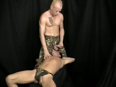 Hot torture scene with two muscled soldiers