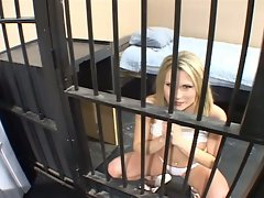 Blonde bitch sucks and is fucked behind bars