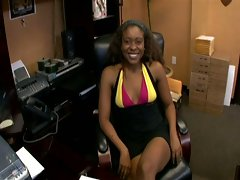 Ebony babe plugged in the office