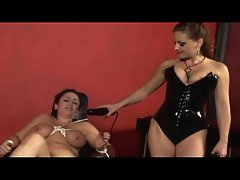 Nasty mistress uses a shock glove to torture this hot slave