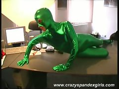 Green spandex catsuit wearing blonde strips down to  pussy