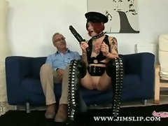 A girl in a very kinky outfit is filmed when she enters the room. She...