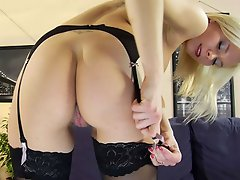 Nylon-loving blonde trying on lacy white and black stockings with a...