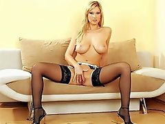 Carol loves wearing sheer black stockings. It really turns her on to...