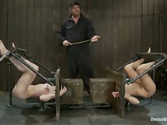 Two friends, captured, bound in hard metal, and fisted until they cum...