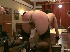 Slave Trainers review the day's slave service...