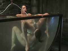 Two sexy slaves are tied together sprayed, dunked and fucked...