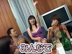 A group of Asian teenagers is having a party game in which all of...