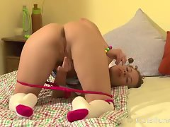 Teen redhead enjoys solo lollipop play