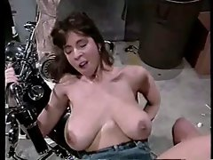 Christy Canyon grinding on a motorbike