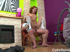 Young vacuums shaft with her mouth