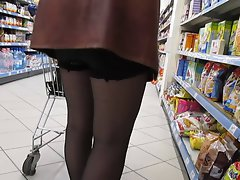 Chick in stockings without panties in a supermarket