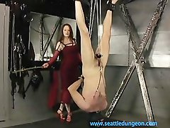 Domme Suspends and Canes Slave Two