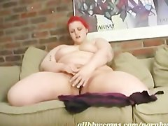 Red head Big beautiful woman sticks rubber toy in fatty sexy fanny 2