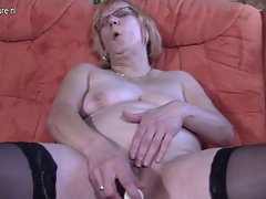 German granny masturbating on the couch