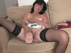Attractive mature cheating wife playing with her toy and saggy hooters
