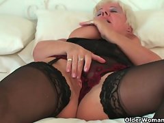 Curvy granny in black stockings rubs her aged clit