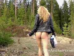 Very hairy blondie Lisa T masturbates her hirsute snatch outside